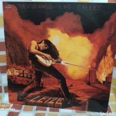 Discos de vinilo: LEIZE–DEVORANDO LAS CALLES . LP VINILO EDICIÓN ORIGINAL DE 1987. BUEN ESTADO. INCLUYE ENCARTE.. Lote 246043610