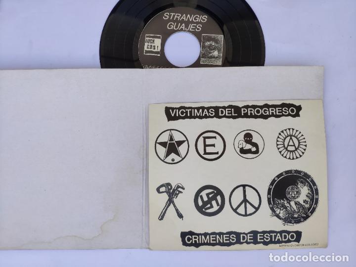 Discos de vinilo: STRANGIS GUAJES - EP Spain PS - MINT * CON LIBRETO * VICTIMAS DEL PROGRESO / CRIMENES DE ESTADO - Foto 2 - 277169818