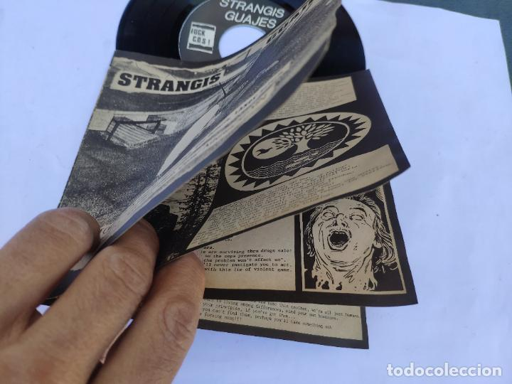 Discos de vinilo: STRANGIS GUAJES - EP Spain PS - MINT * CON LIBRETO * VICTIMAS DEL PROGRESO / CRIMENES DE ESTADO - Foto 4 - 277169818