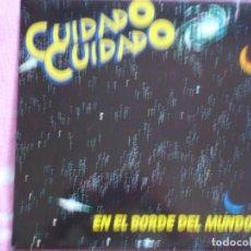 Discos de vinilo: CUIDADO CUIDADO,EN EL BORDE DEL MUNDO ALBUN CON 8 TEMAS DEL 86. Lote 279520368
