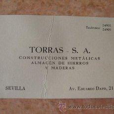 Documentos antiguos: TARJETA COMERCIAL EMPRESA TORRAS,CONSTRUCCIONES METALICAS,ALMACEN HIERROS Y MADERAS,SEVILLA,AÑOS 50. Lote 29683977