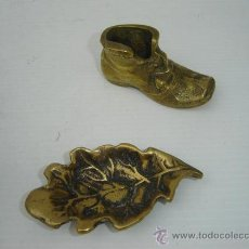 2 pisapapeles de bronce