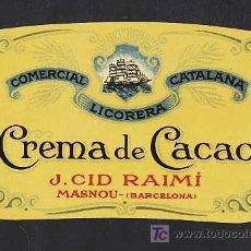 Etiquetas antiguas: ETIQUETA DE LICOR CREMA DE CACAO DE J.CID DEL MASNOU. TROQUELADA. Lote 4405822