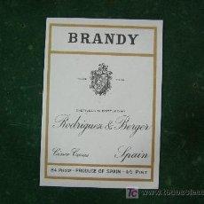 Etiquetas antiguas: ANTIGUA ETIQUETA DE BRANDY RODRIGUEZ & BERGER. CINCO CASAS CIUDAD REAL 8,5X12CM. Lote 194764138