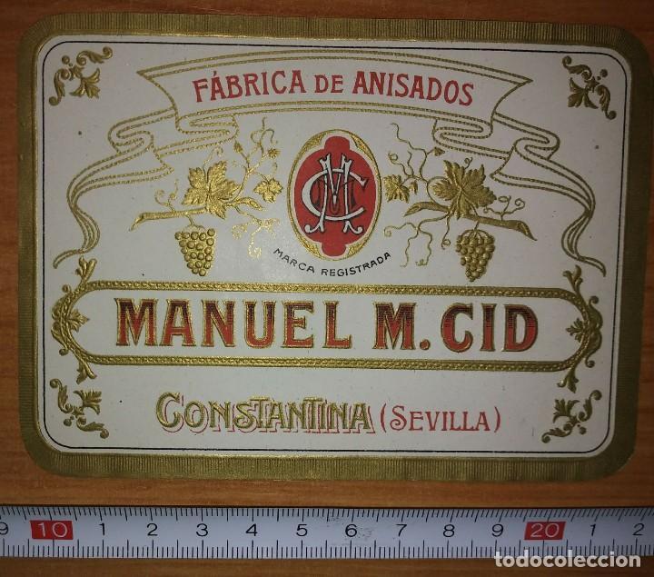 ETIQUETA FABRICA DE ANISADOS MANUEL M.CID CONSTANTINA SEVILLA (Coleccionismo - Etiquetas)