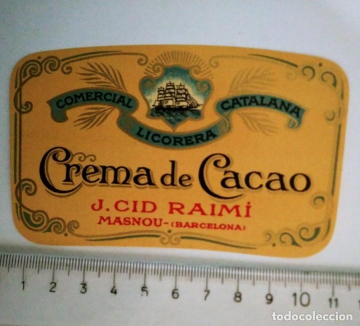 ETIQUETA CREMA DE CACAO COMERCIAL LICORERA CATALANA J.CID RAIMÍ MASNOU BARCELONA (Coleccionismo - Etiquetas)
