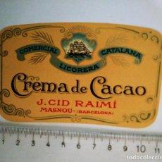 Etiquetas antiguas: ETIQUETA CREMA DE CACAO COMERCIAL LICORERA CATALANA J.CID RAIMÍ MASNOU BARCELONA. Lote 119891247