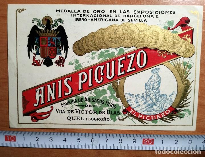 Etiquetas antiguas: Anis Picuezo. Antigua etiqueta con escudo franquista. Fábrica de anisados finos. Quel. Logroño - Foto 2 - 114778107