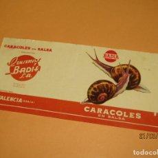Etiquetas antiguas: ANTIGUA ETIQUETA DE BOTE DE CARACOLES EN SALSA DE CONSERVAS BADIA EN VALENCIA - AÑO 1960-70S.. Lote 156407222