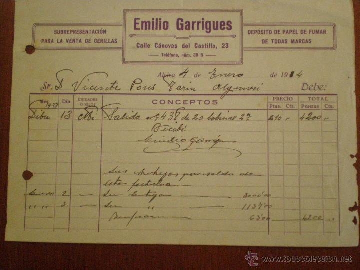 1934 ALCIRA (VALENCIA). FACTURA DE EMILIO GARRIGUES, VENTA DE CERILLAS Y PAPEL DE FUMAR. (Coleccionismo - Documentos - Facturas Antiguas)