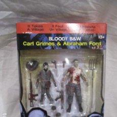 Figuras de acción: THE WALKING DEAD CARL GRIMES & ABRAHAM FORD DE MCFARLANE. Lote 207423611