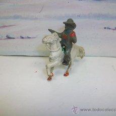 Figuras de Goma y PVC: RARO VAQUERO DE PECH EN GOMA TAMAÑO PEQUEÑO - LAFREDO. Lote 27636837
