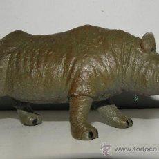 Figuras de Goma y PVC: RINOCERONTE DE PVC UNOS 10 CM. Lote 38719517