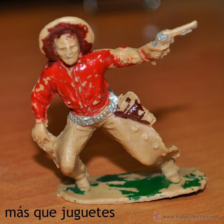 FIGURA DE UN VAQUERO O COWBOY MEDIO CAIDO DE REAMSA. (Juguetes - Figuras de Goma y Pvc - Reamsa y Gomarsa)