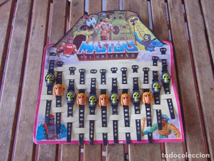 12 RELOJES,RELOJ EN BLISTER EXPOSITOR COMPLETO DE LOS MASTERS DEL UNIVERSO MATTEL 1985 (Juguetes - Figuras de Acción - Master del Universo)