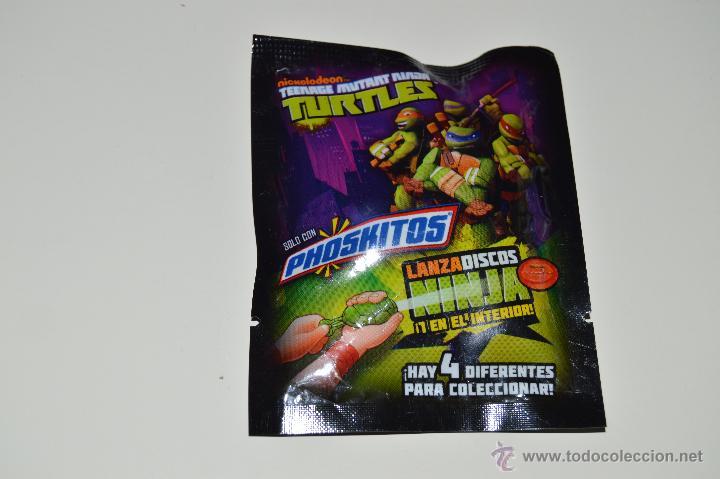 SOBRE PRECINTADO CON UN LANZADISCOS NINJA DE LA SERIE TEENAGE MUTANT NINJA TURTLES (PHOSKITOS) (Juguetes - Figuras de Acción - Tortugas Ninja)