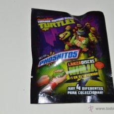 Figuras y Muñecos Tortugas Ninja: SOBRE PRECINTADO CON UN LANZADISCOS NINJA DE LA SERIE TEENAGE MUTANT NINJA TURTLES (PHOSKITOS). Lote 49740435