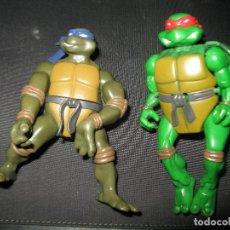 Figuras y Muñecos Tortugas Ninja: DOS FIGURAS DE LAS TORTUGAS NINJA UNA DE ELLAS SE TRANSFORMA EN OTRA. Lote 135492622