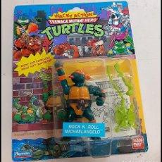 Figuras y Muñecos Tortugas Ninja: FIGURA TORTUGAS NINJA EN SU CAJA ORIGINAL NUEVO ROCK N ROLL MICHAELANGELO. Lote 263016470