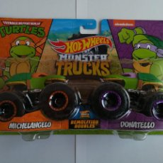 Figuras y Muñecos Tortugas Ninja: HOT WHEELS MONSTER TRUCKS TORTUGAS NINJA SET DE DOS (MICHELANGELO Y DONATELLO) TMNT. Lote 267220869