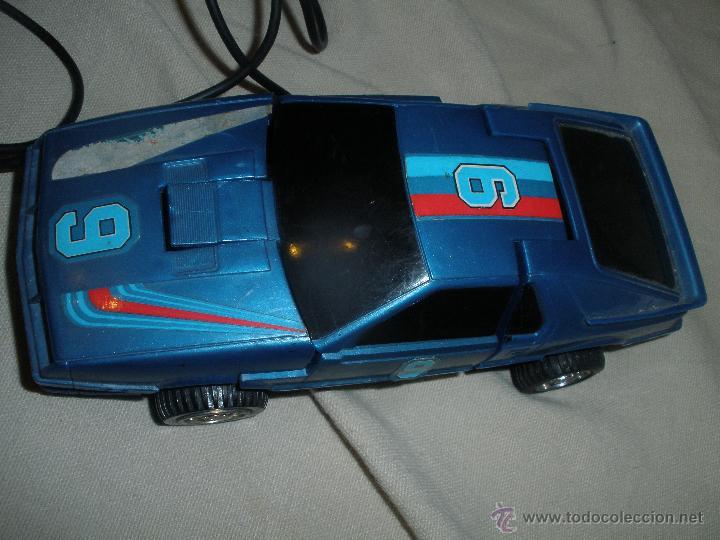 COCHE TRANSFORMER,DIRIGIDO POR CABLE,FABRICADO EN HONG KONG. (Juguetes - Figuras de Acción - Transformers)