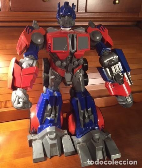 Figuras y Muñecos Transformers: ROBOT TRANSFORMER HASBRO 2008 OPTIMUS PRIME BOTELLA 28CMX23CM15CM - Foto 2 - 136745902