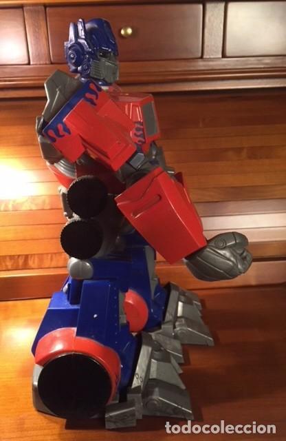Figuras y Muñecos Transformers: ROBOT TRANSFORMER HASBRO 2008 OPTIMUS PRIME BOTELLA 28CMX23CM15CM - Foto 3 - 136745902
