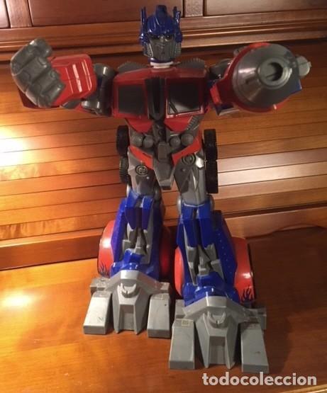 Figuras y Muñecos Transformers: ROBOT TRANSFORMER HASBRO 2008 OPTIMUS PRIME BOTELLA 28CMX23CM15CM - Foto 6 - 136745902