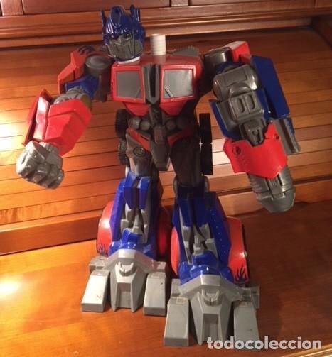 Figuras y Muñecos Transformers: ROBOT TRANSFORMER HASBRO 2008 OPTIMUS PRIME BOTELLA 28CMX23CM15CM - Foto 7 - 136745902