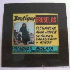 Fotografía antigua: DIAPOSITIVA PUBLICIDAD BOUTIQUE BRUSELAS, MISLATA, PARA CINE AÑOS 60 APROX (8,5X8,5CM APROX). Lote 28394567