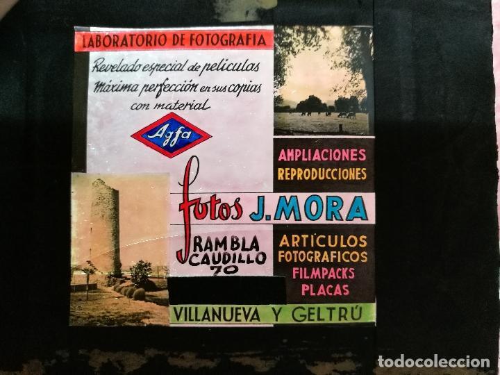DIAPOSITIVA CRISTAL PUBLICIDAD SALAS DE CINE.PERFUMERIA FOTOS J.MORA VILLANUEVA Y GELTRU 1943-REF-ML (Fotografía Antigua - Diapositivas)