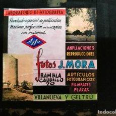 Fotografía antigua: DIAPOSITIVA CRISTAL PUBLICIDAD SALAS DE CINE.PERFUMERIA FOTOS J.MORA VILLANUEVA Y GELTRU 1943-REF-ML. Lote 149223426