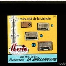 Fotografía antigua: DIAPOSITIVA DE CRISTAL PUBLICIDAD RADIO TELEVISIÓN IBERIA - FERRETERÍA LA MALLORQUINA. Lote 204350752