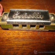 Instrumentos musicales: MINUSCULA ARMONICA ESTRELLA. 4,50 X 1,50 CM.. Lote 24400566