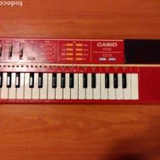 Instrumentos musicales: ORGANO TECLADO CASIO PT 82. ROJO. FUNCIONA. SIN ROM.. Lote 117575303