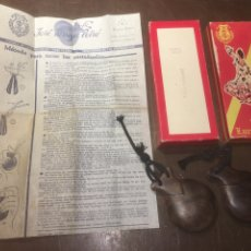 Instrumentos musicales: PAREJA DE CASTAÑUELAS DE GRANADILLO ENCAJA A ESTRENAR - MARCA JOSE TARREGA - LUCERO TENA - AÑOS 70. Lote 187177348