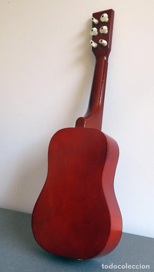 Instrumentos musicales: Guitarra de juguete. Caja y mastil de madera. 59 cm largo x 20 cm ancho. Buen estado - Foto 4 - 243253200