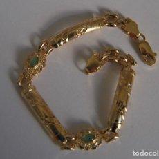 Joyeria - Pulsera de oro 18 kt.,con rosetas de Esmeraldas y Circones brillantes. - 122953000