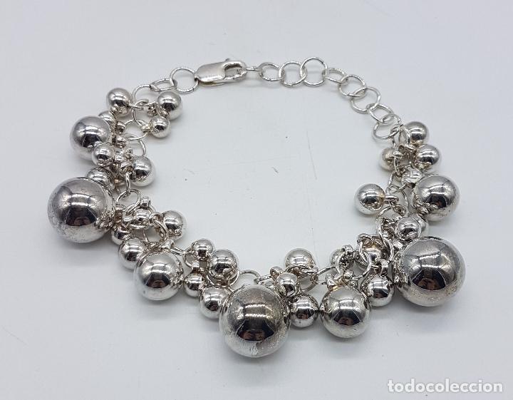 4c4aa95f6992 Original pulsera vintage en plata de ley contrastada con dijes en forma de  perla de varios tamaños .