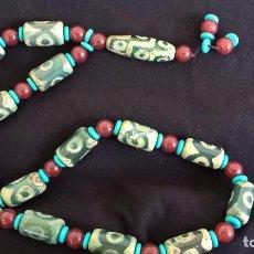 Joyeria - Collar tibetano antiguo de ágata dzi y turquesa. 17 Dzi de 3 y 9 ojos. Nepal. Siglo XX. - 105366611