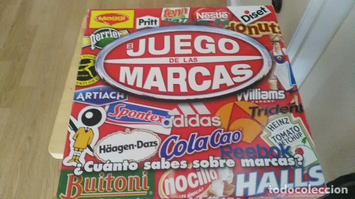 EL JUEGO DE LAS MARCAS. DISET 2010. ORIGINAL. COMPLETO. NUEVO. TABLERO, 6 PEONES, 396 TARJETAS. (Juguetes - Juegos - Juegos de Mesa)