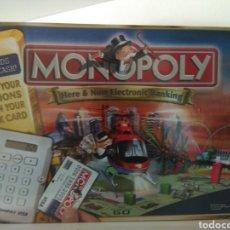 Juegos de mesa: MONOPOLY HERE NOW UK 2006. Lote 179954155