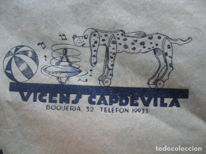 Juguetes antiguos: Antiguo pliego de envolver Gran bazar de joguines Vicens Capdevila Barcelona años 30 - Foto 10 - 194611837
