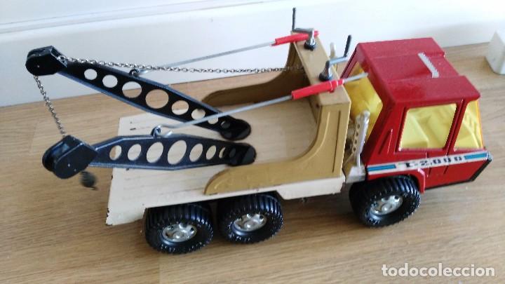 Juguetes antiguos Gozán: CAMION DE GOZAN TIGRE 2000 Un camión de chapa de la casa Gozan Le falta una cadena - Foto 3 - 76072291