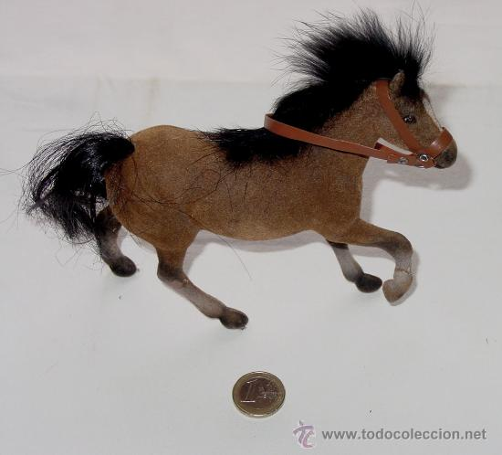 caballo de plastico forrado de una especie de t  Comprar en