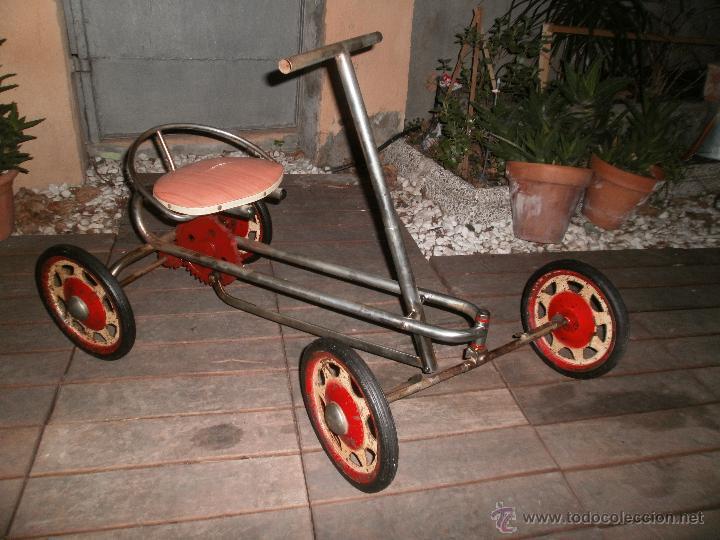 coche de juguete para nios a traccin manual y dirigido con los pies aos