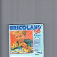 Juguetes antiguos y Juegos de colección: BRICOLAND MINI NESTLE CHAMBURCY MODELO 2. Lote 95553387