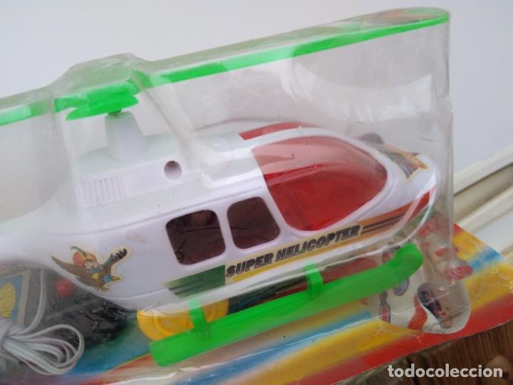 Juguetes antiguos y Juegos de colección: helicoptero kiosko años 80 - Foto 2 - 240925895