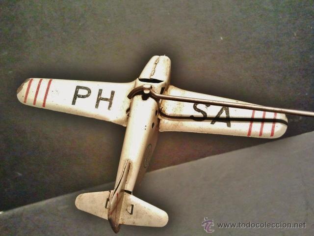 Juguetes antiguos Payá: Antiguo balancín con avión y hangar de Payá. Año 1950. - Foto 5 - 41700569
