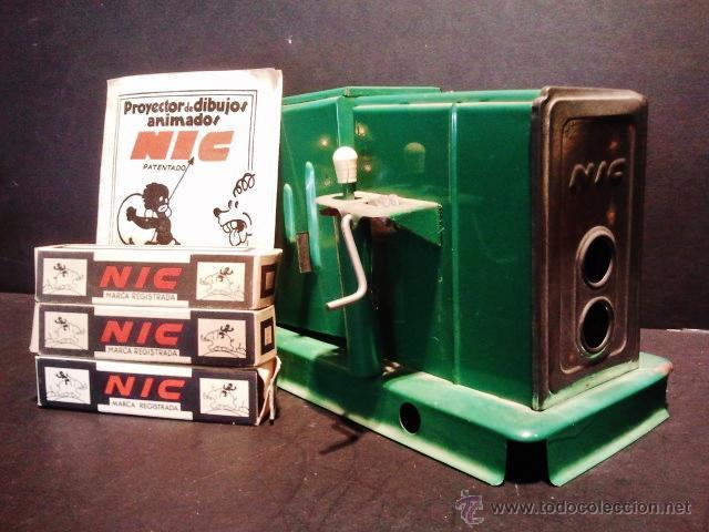 Juguetes Antiguos: Proyector de dibujos animados NIC. Años 30. Pluto Sonánbulo, Pluto cazador y El gato con botas. - Foto 2 - 40330602